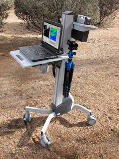 PolarCam mobile rig showing laptop computer, battery, tripod and cart.